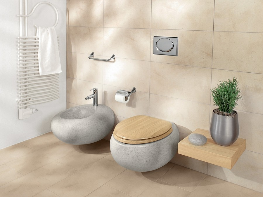 1-wall-mounted-hung-floating-toilet-bidet-in-bathroom-interior-design-naturalistic-light-wood-cover-rounded-smooth-shape-elegant-pebble-form-beige-wall-floor-tiles