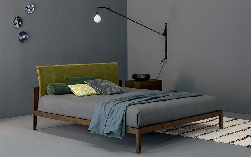 2-minimalist-contemporary-style-interior-design-greenery-gray-velvet-upholstered-bed-headboard-gray-big-wall-mounted-hinged-lamp-rug-black-and-white