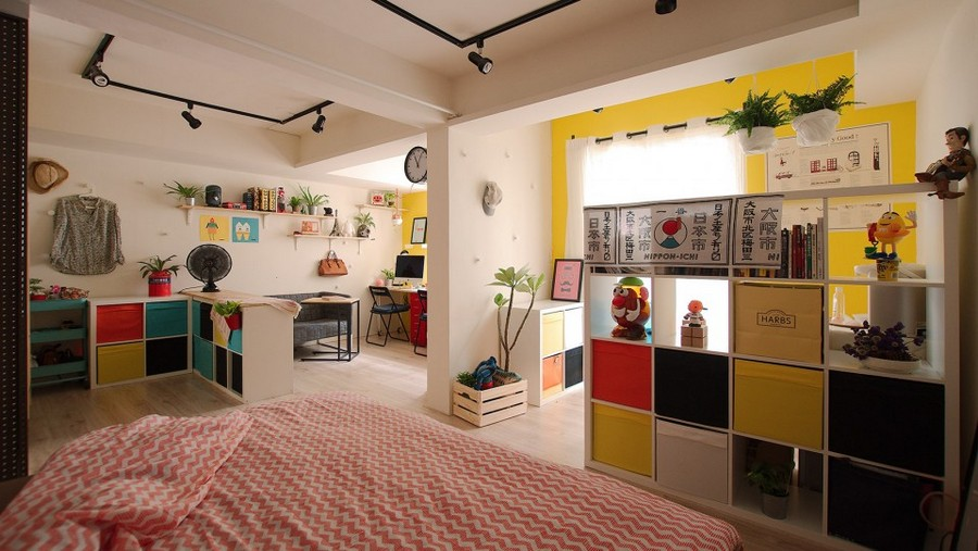 2-studio-apartment-design-light-floating-wood-floor-track-lights-beige-walls-red-blue-yellow-accents-shelving-units