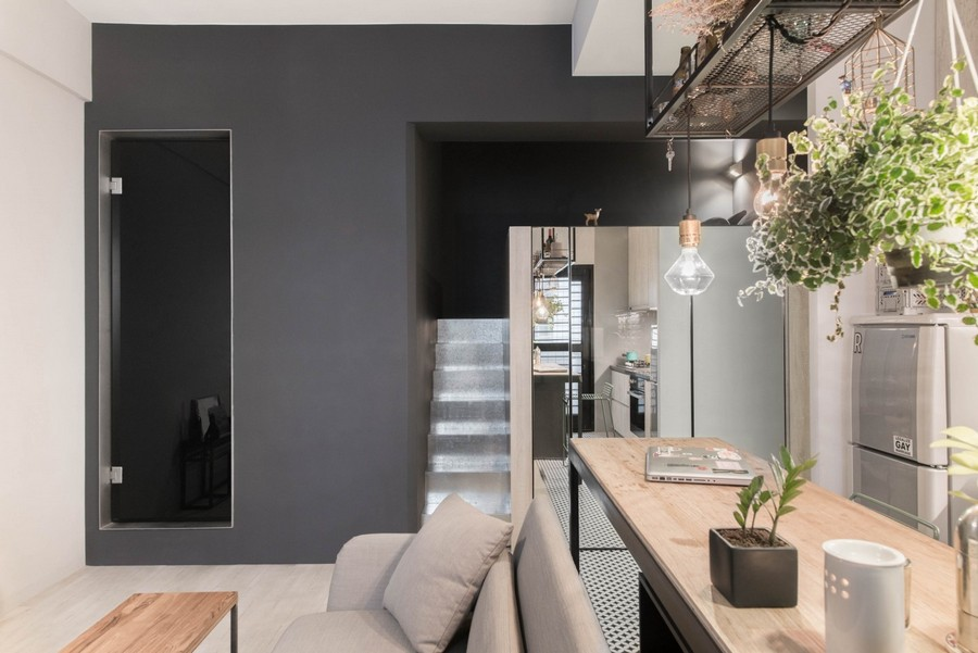 3-1-tiny-small-single-woman's-studio-apartment-Taiwan-gray-walls-floor-black-interior-design-accents-light-wood-graphite-sofa-loft-bed-staircase-mirrored-wardrobe-storage-zone-underneath