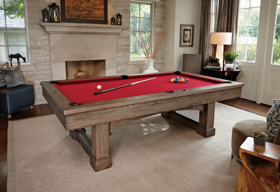 3-light-traditional-style-living-billiards-pool-room-table-natural-wood-bed-red-cloth-fireplace-windows-arm-chairs-lamps-neutral-interior-rug