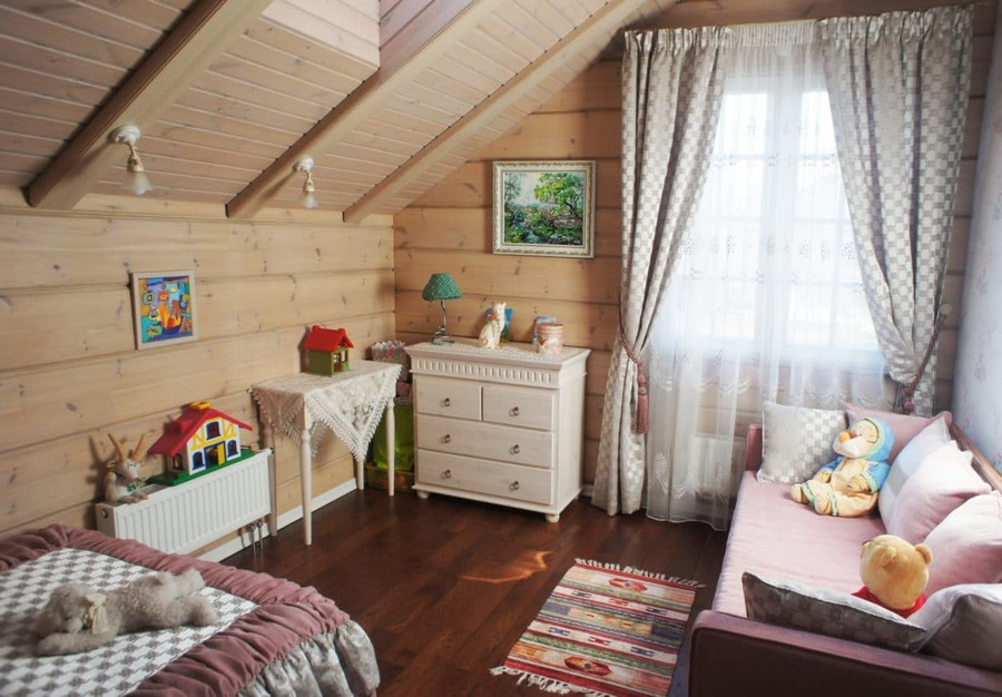 4-2-log-timber-wooden-house-interior-design-walls-sloped-ceiling-skylight-overdrapery-drapery-sheer-curtains-pink-gray-beige-bed-cover-pleats-sofa-chest-of-drawers-throw-pillows-bed-kids-toddler-room-bedroom