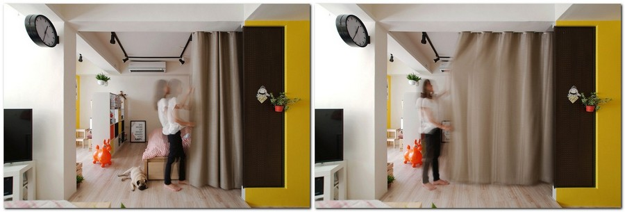 4-2-studio-apartment-design-light-floating-wood-floor-track-lights-beige-walls-red-yellow-accents-curtained-bed-bedroom-zone-area-sleeping-perforated-board
