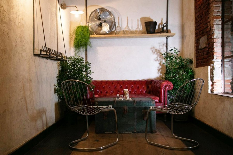 5-2-Gesto-restaurant-cafe-bar-in-Milan-Italy-loft-style-interior-design-metal-chairs-red-leather-chester-sofa-vintage-chest-box