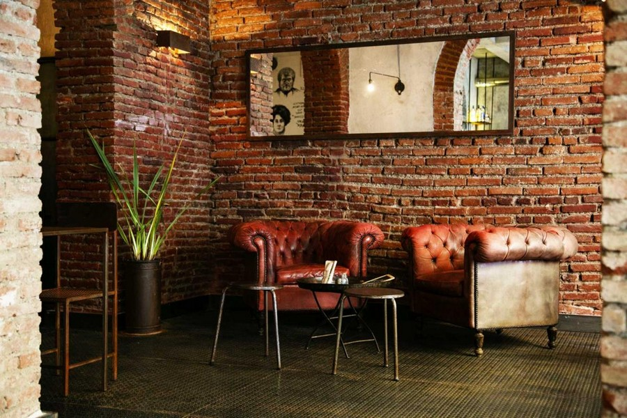 5-5-Gesto-restaurant-cafe-bar-in-Milan-Italy-loft-style-interior-design-old-brick-masonry-metal-stools-chairs-red-leather-arm-chairs
