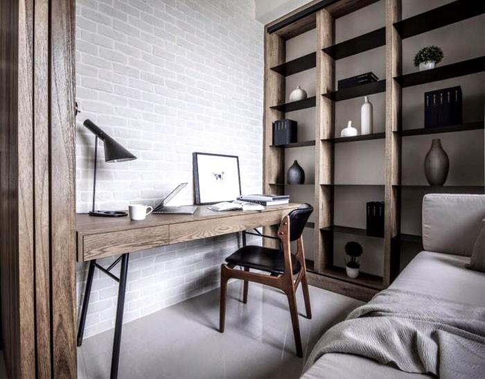 5-contemporary-minimalist-naturalistic-style-interior-design-white-walls-glossy-floor-gray-black-accents-wood-grain-study-work-area-shelving-unit-desk-chair-sofa