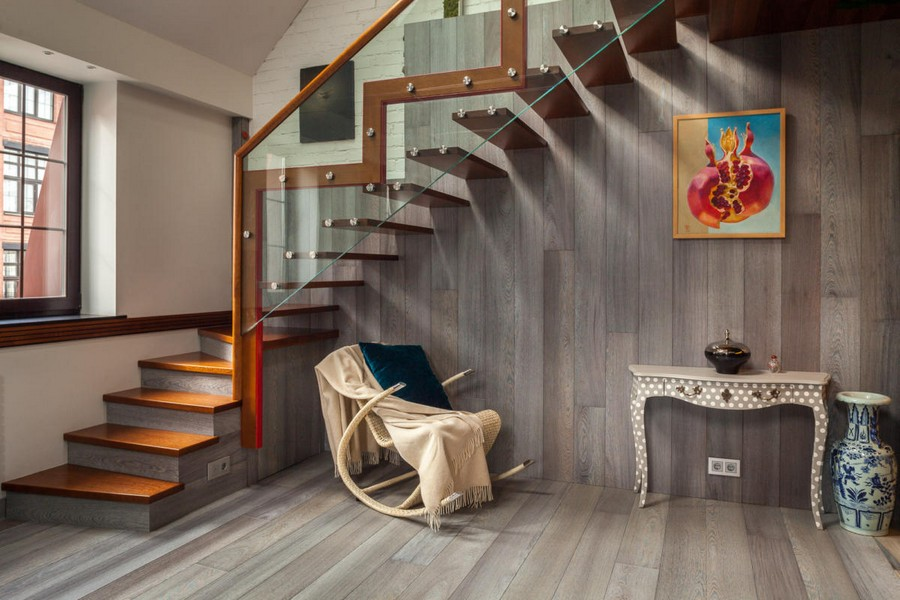 5-contemporary-style-living-room-interior-design-metal-wooden-glass-staircase-gray-blue-parquetry-walls-floor-console-with-curved-legs-rocking-chair-vase-blanket