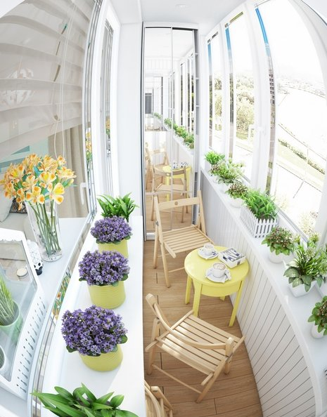 5-small-narrow-loggia-balcony-interior-design-light-laminate-floor-white-walls-yellow-accents-IKEA-furniture-folding-chairs-coffee-table-with-a-drawer-flower-pots