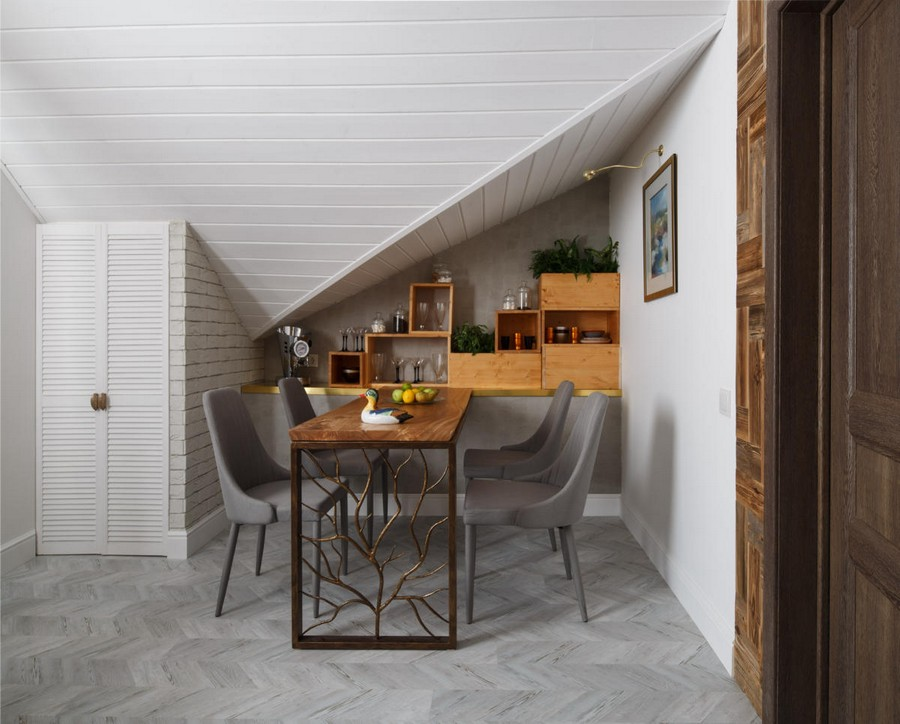 6-1-contemporary-style-attic-interior-metal-forged-dining-table-sloped-ceiling-white-walls-gray-chairs-living-room-dining-area-naturalistic-corkwood-floor-wooden-shelving-unit-mosular-slab-top