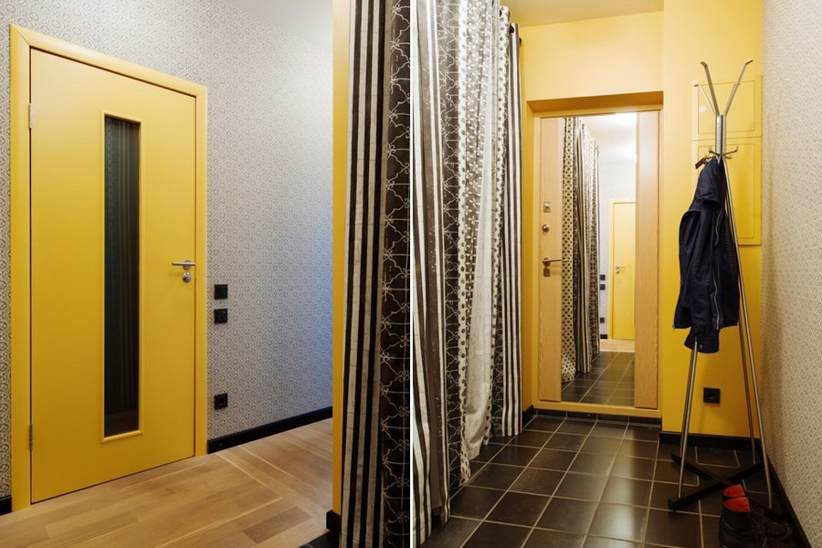 6-bachelor's-interior-design-corridor-yellow-door-wall-light-blue-black-and-white-draw-curtains-floor-coat-rack