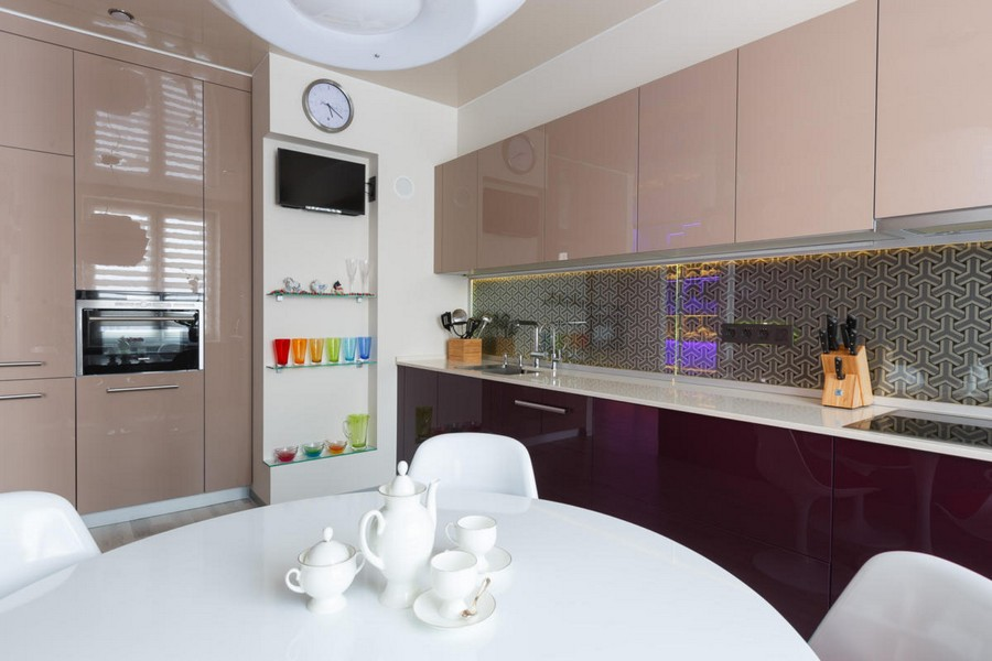 7-1-beautiful-creative-kitchen-backsplash-ideas-beige-and-purple-glossy-cabinets-metalized-TRIFID-wallpaper-Osborne-&-Little- protected-by-tempered-glass-interior-design