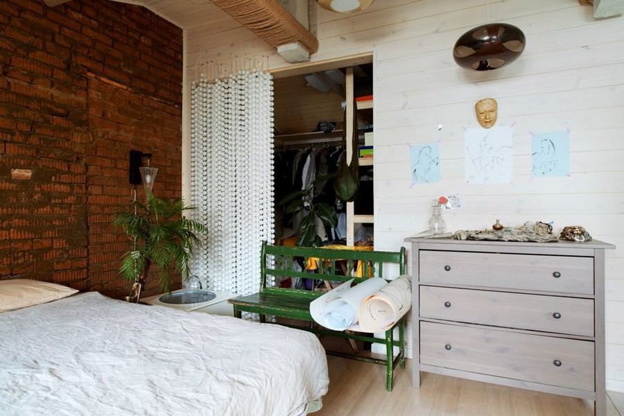 7-eclectic-style-bedroom-interior-design-in-the-loft-attic-sloped-ceiling-brick-wall-wheeled-coffee-table-stuffed-sheep-handmade-curtains-from-ping-pong-table-tennis-balls-chest-of-drawers-green-vintage-bench