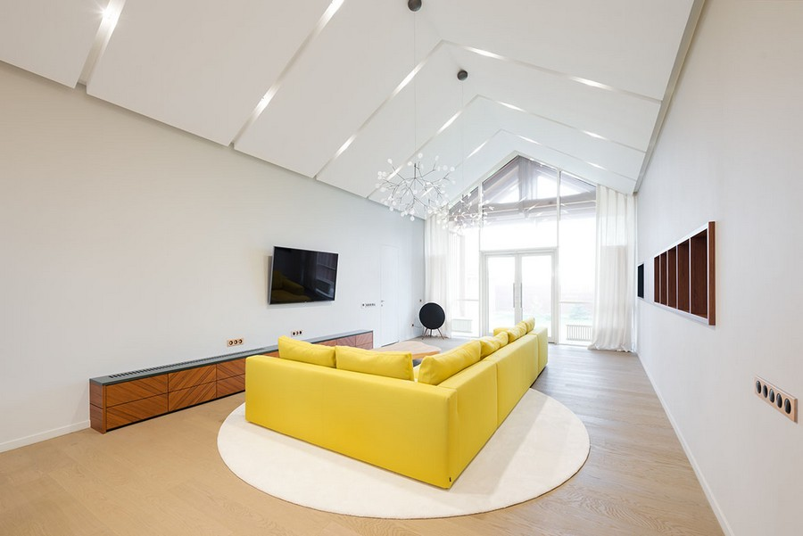 9-1-open-concept-living-room-lounge-zone-interior-design-in-contemporary-style-white-walls-minimalism-spacious-big-yellow-corner-sofa-panoramic-window-timber-house-wooden-cabinets