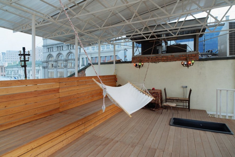9-roof-exit-from-an-apartment-wooden-terrace-hammock-bench-attic-loft-floor