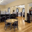 Tappe-Architects-small-town-LEED-platinum-Athol-Public-lbrary-Massachusetts-USA-interior-design-historic-Carnegie-part-vintage-yellow-hard-pine-floor-dark-woos-desks-arched-windows
