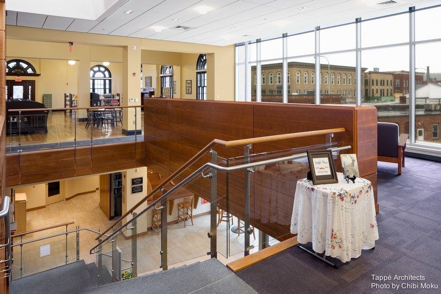 Tappe-Architects-small-town-LEED-platinum-Athol-Public-lbrary-Massachusetts-USA-interior-design-staircase-glass-railings-arched-panoramic-windows-lounge-area-Carnegie-part-historic