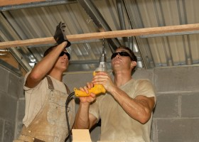 1-builders-with-a-driller-carrying-out-roofing-works