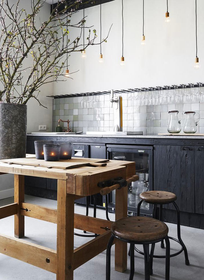 11-natural-solid-charred-burnt-wood-kitchen-cabinets-set-interior-design-wine-glass-holders-drier-rough-dining-table-stools-white-wall-black-floor-exposed-wires-loft-bulbs-lamps
