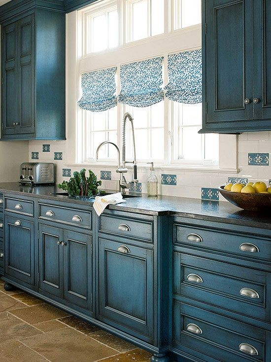 19-classical-American-style-patina-effect-blue-kitchen-cabinets-set-interior-tall-narrow-windows-sink-retro-style-1950s-appliances-fruit-bowl-faucet-roman-blinds