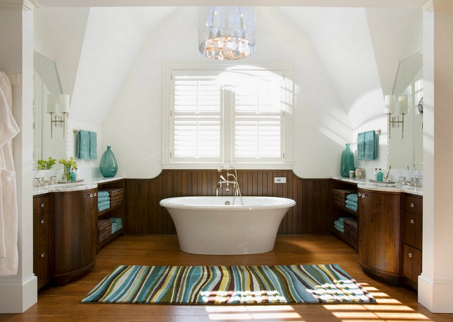 2-warm-cozy-bathroom-interior-design-symmetrical-furniture-arrangement-stripy-rug-free-standing-bath-bathtub-sloped-ceiling-two-wash-basins-open-racks-towel-storage-white-marble-countertop-chandelier