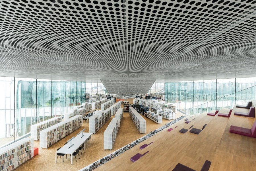 3-3-Alexis-de-Tocqueville-Public-Library-Caen-France-interior-design-wooden-stairs-seats-books-bookshelves-panoramic-windows-high-ceiling