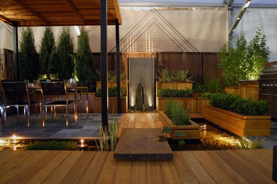 3-7-outdoor-garden-landscape-lighting-ideas-pond-underwater-lights-wooden-deck-dining-area-table-chairs
