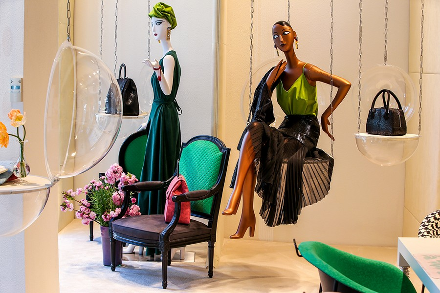 4-3-new-show-room-concept-store-in-Milan-Italy-2017-Alcantara-material-collection-in-interior-design-purple-and-green-arm-chair-suspended-decor-mannequins-fashion-looks-Rebecca-Moses