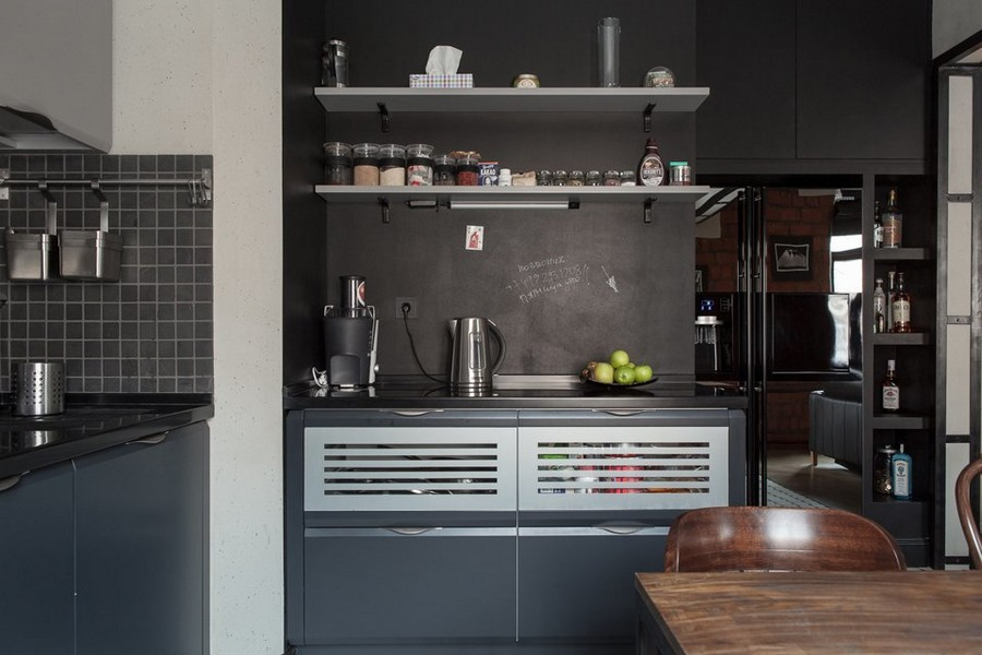 6-1-bachelor's-pad-interior-design-loft-style-brutal-blck-kitchen-set-open-racks-chalkboard-wall-square-tiles-backsplash-built-in-refrigerator-with-top-cabinet-above-home-bar
