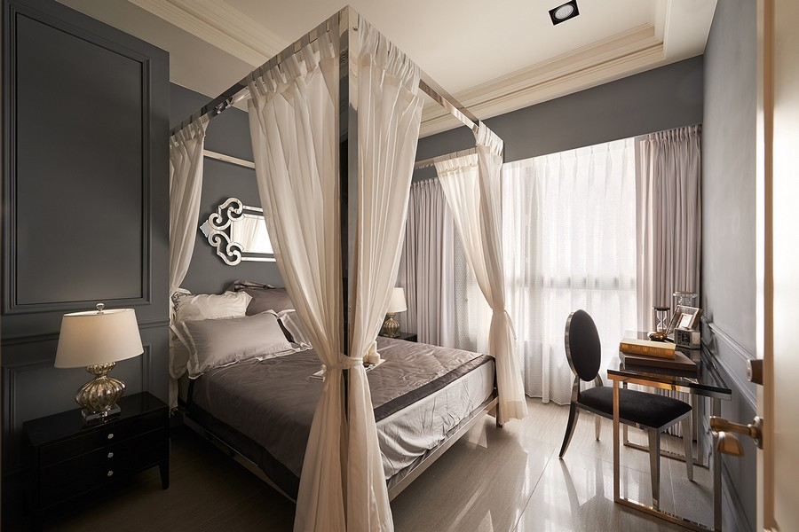 6-1-neo-classical-contemporary-style-interior-gray-and-white-bedroom-canopy-bed-wall-panels-moldings-glossy-mirrored-furniture-surfaces-nightstand-dressing-table-chair-desk-mirror