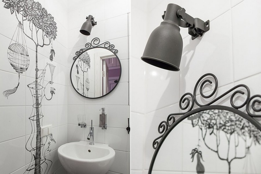6-2-contemporary-style-bathroom-interior-black-and-white-wall-tiles-decor-fairy-tale-motifs-wrought-metal-mirror-frame-track-light