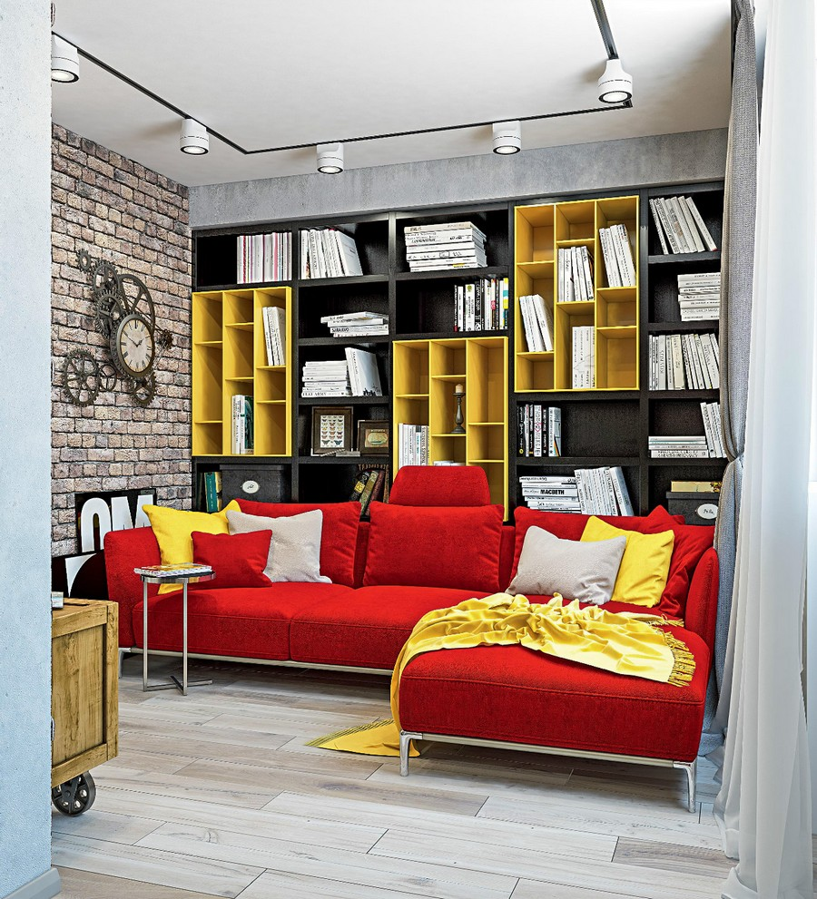 1-1-industrial-loft-style-bright-interior-design-with-red-and-yellow-accents-lounge-living-room-corner-sofa-shelving-unit-wall-to-wall-bookshelves-track-lights-faux-brick-wall-wheeled-chest-steampunk-clock-exposed
