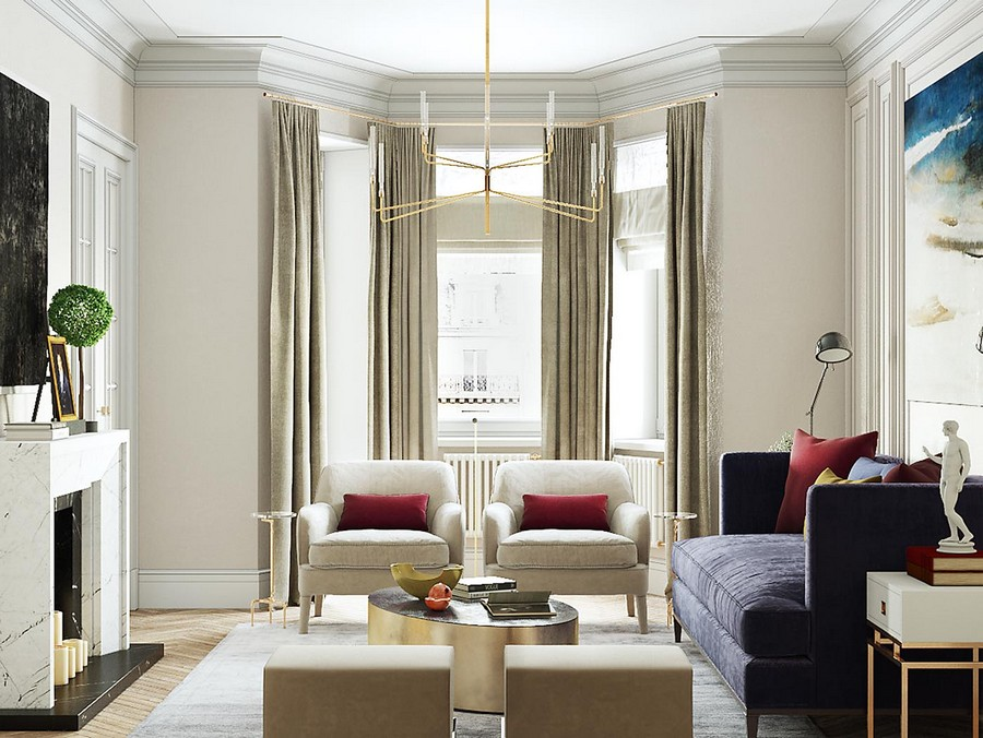 1-1-modern-neo-classical-style-interior-design-living-room-bay-window-beige-walls-symmetrical-furniture-arrangement-brass-chandelier-blue-sofa-red-accents-throw-pillows-artwork-wall-art-faux-fireplace-arm-chairs