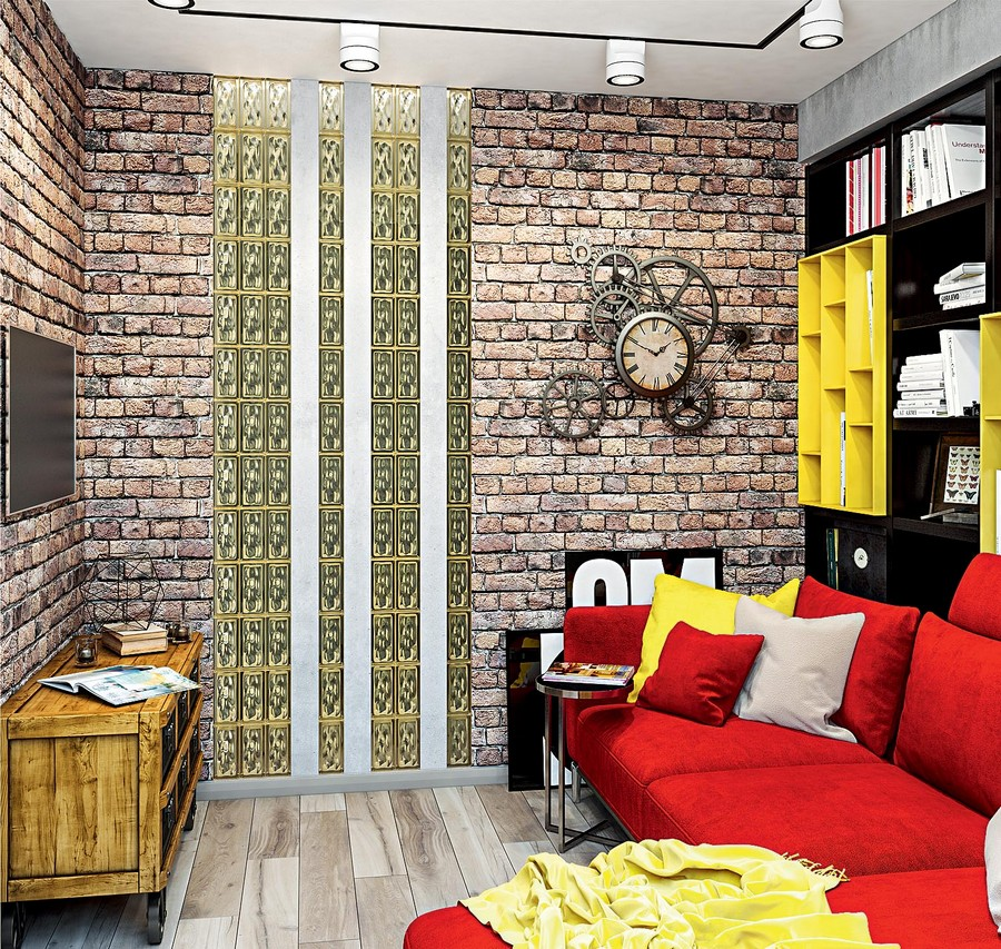 1-2-industrial-loft-style-bright-interior-design-with-red-and-yellow-accents-lounge-living-room-corner-sofa-shelving-unit-bookshelves-track-lights-faux-brick-wall-wheeled-chest-steampunk-clock-glass-block-wall-TV
