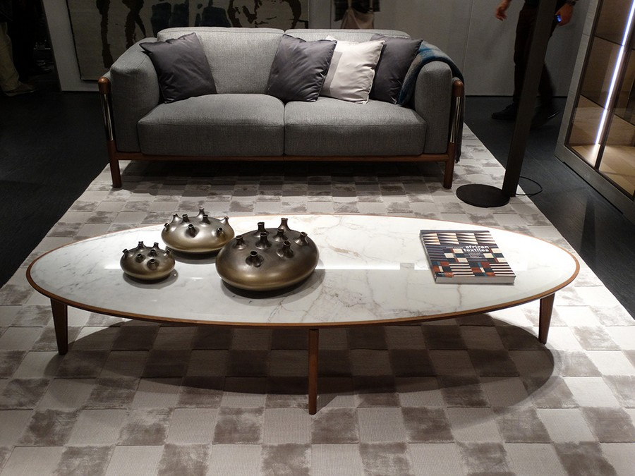 1-7-Giorgetti-new-collection-of-contemporary-style-furniture-at-Salone-de-Mobile-Exhibition-Milan-2017-soft-sofa-gray-oval-coffee-table-candlesticks-chqurered-rug