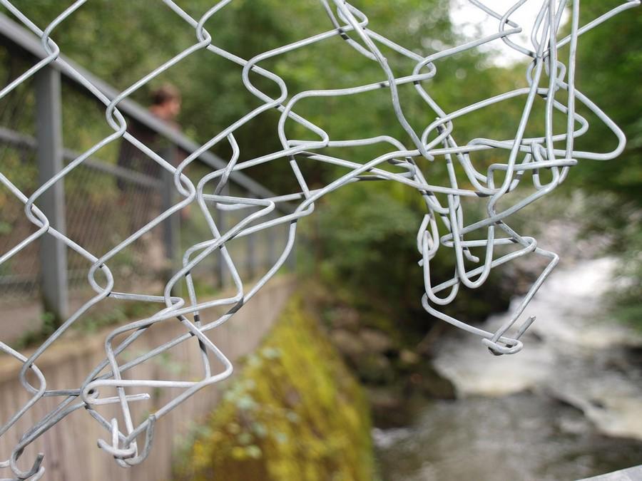 1-violation-of-property-trespass-tort-broken-iron-mesh-fence