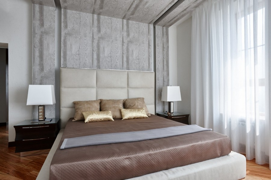 2-2-contemporary-style-interior-design-light-pastel-beige-brownish-gray-bedroom-nightstands-white-bedside-lamps-parquet-floor-diagonal-pattern-gray-wooden-panels-ceiling-decor-upholstered-headboard-wall