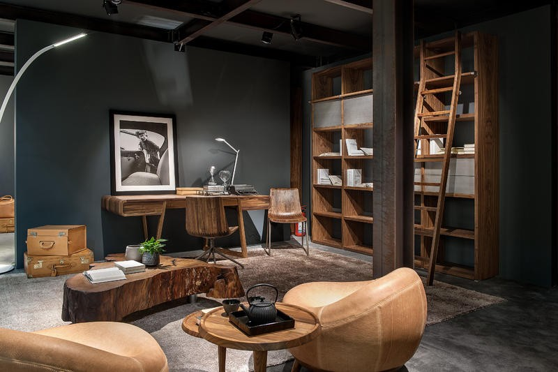 2-3-Riva-1920-new-collection-of-contemporary-style-furniture-at-Salone-de-Mobile-Exhibition-Milan-2017-rough-wooden-tree-trunk-crosscut-coffee-table-arm-chair-desk-bookshelves-home-library-ladder