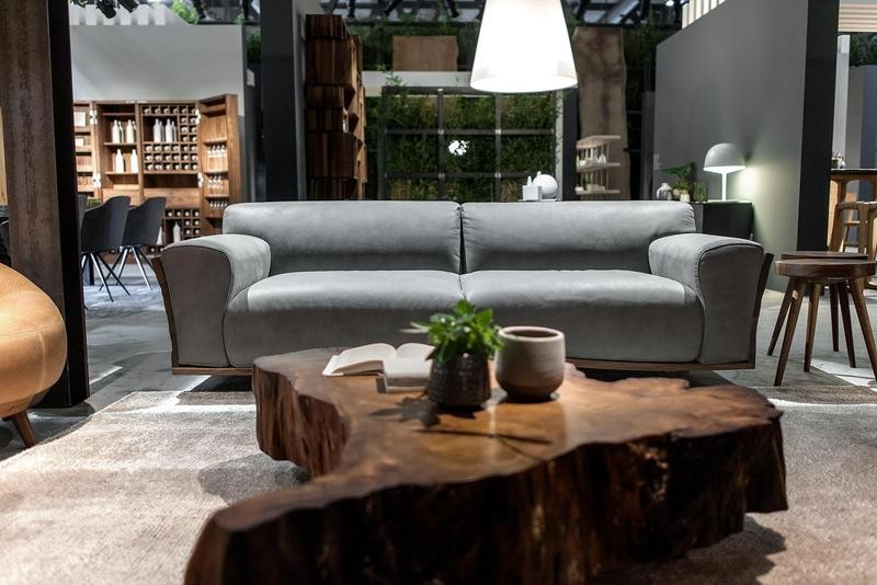 2-7-Riva-1920-new-collection-of-contemporary-style-furniture-at-Salone-de-Mobile-Exhibition-Milan-2017-rough-wood-solid-tree-trunk-cross-cut-piece-coffee-table-blue-sofa-gray-walls-living-room-interior-design