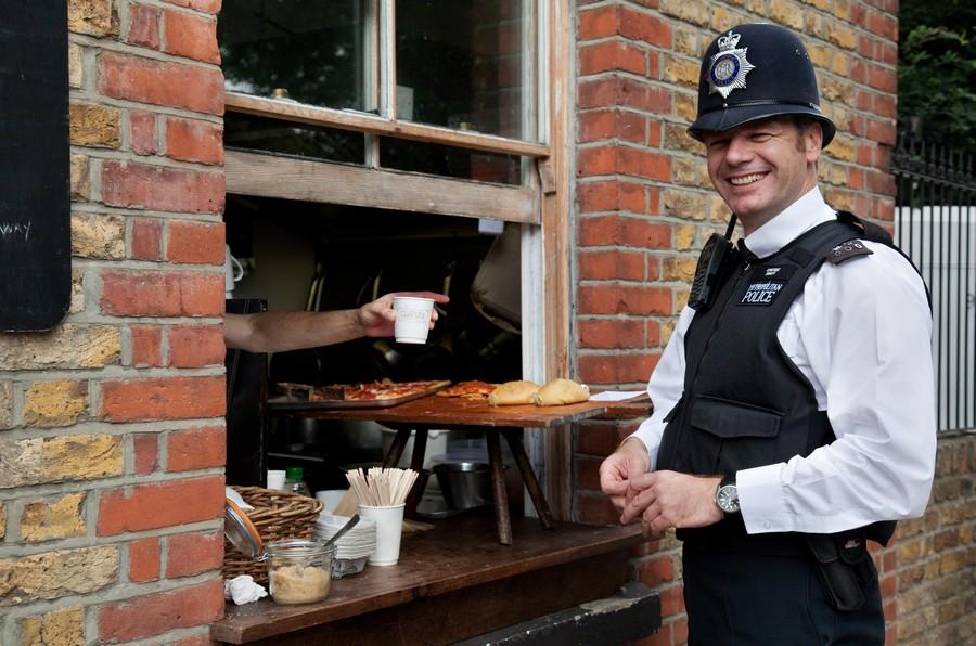 2-London-funny-british-english-policeman-buying-lunch-smiling-metropolitan-police-uk-London-friendly