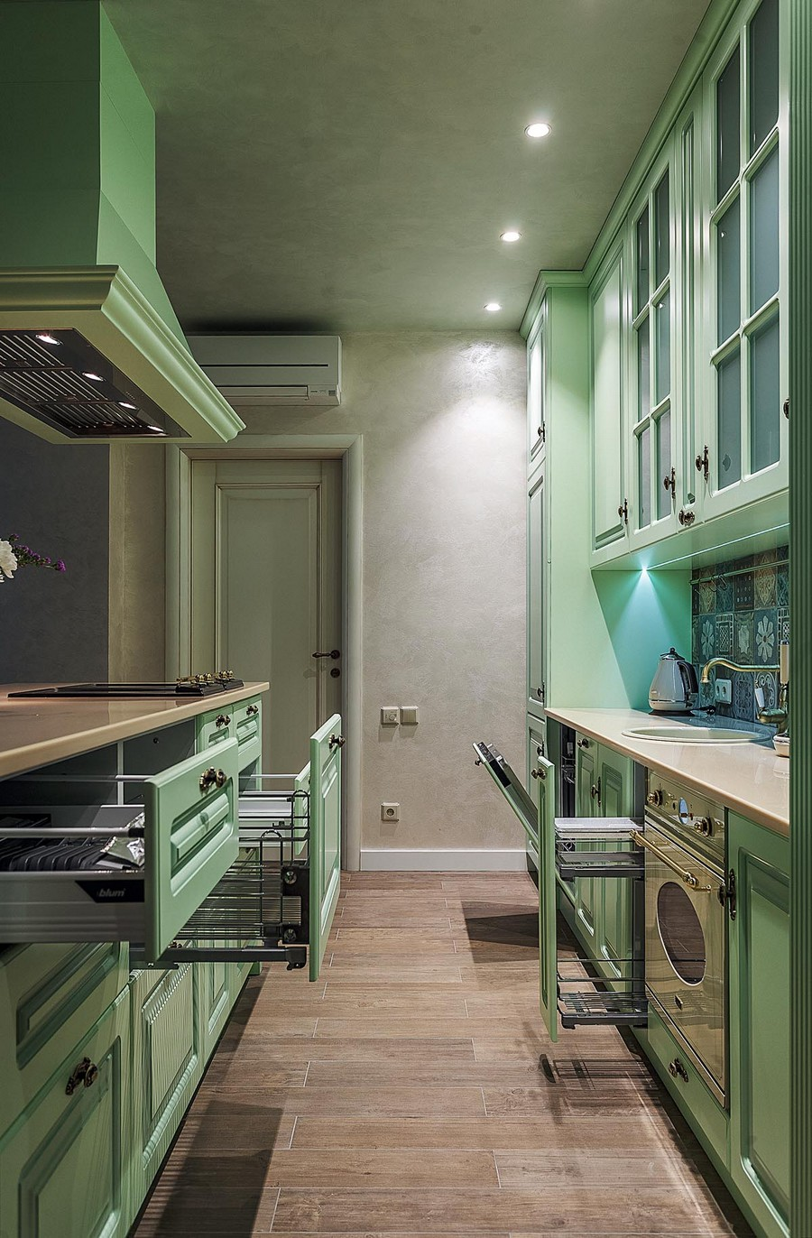 2-pale-mint-green-kitchen-interior-design-in-Mediterranean-style-island-soild-wood-cabinets-beige-worktop-cooker-hood-glass-cabinets-drawers-stove-brass-faucet-handles-rails