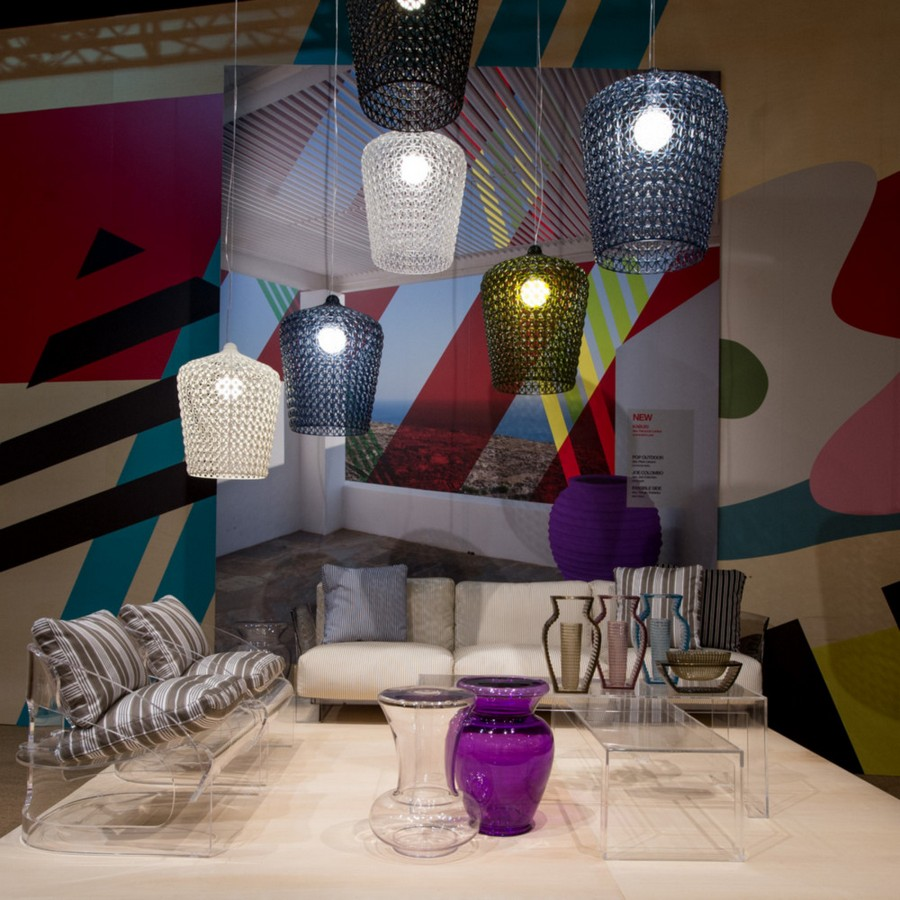 3-6-Kartell-new-collection-of-contemporary-style-furniture-at-Salone-de-Mobile-Exhibition-Milan-2017-living-room-interior-design-beige-rug-multicolor-suspended-glass-lamps-transparent-coffee-table-vases-arm-chairs-stripy