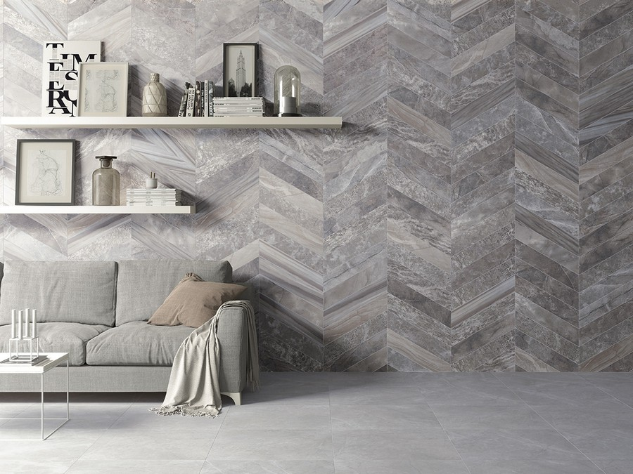 4-3-ceramic-tiles-in-living-room-interior-design-gray-walls-herringbone-pattern-open-racks-sofa-Saloni-brand-collection-2017