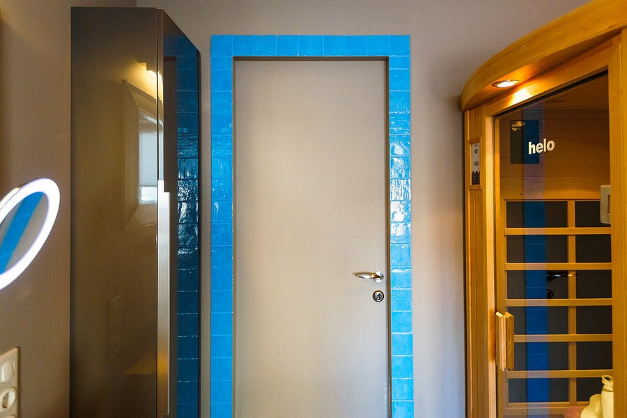 5-1-modern-bathroom-interior-design-with-walk-in-infrared-home-sauna-azure-blue-tiles-gray-painted-wall-door-tall-wall-mounted-storage-cabinet