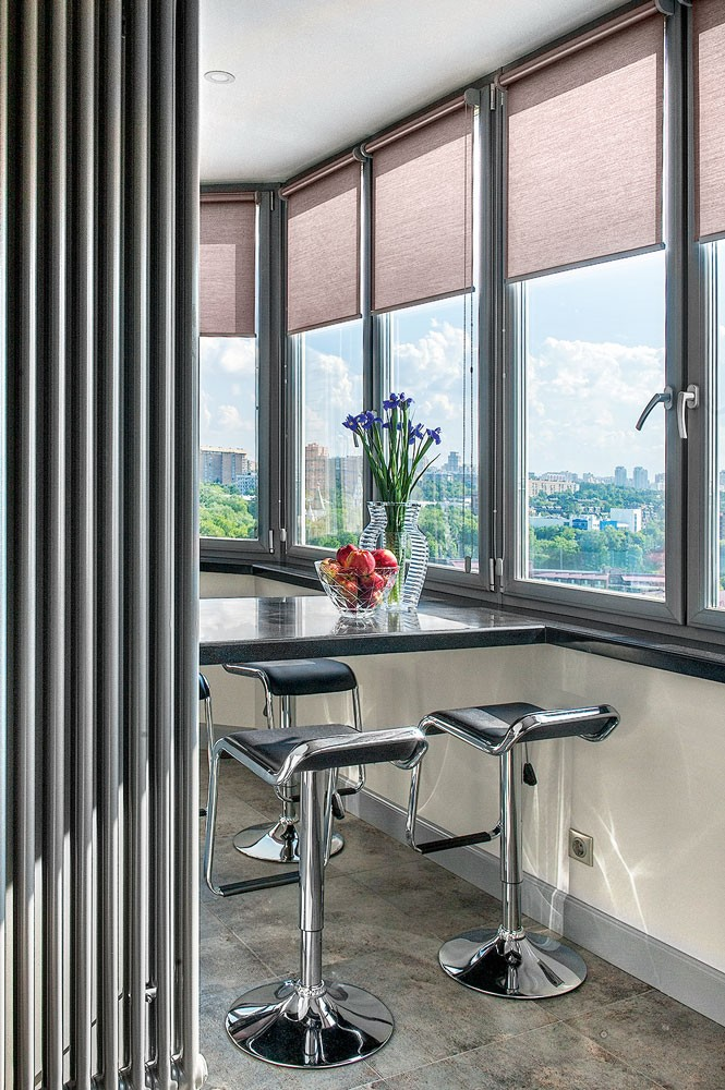 5-art-deco-style-recessed-balcony-loggia-interior-design-bar-table-stools-roman-blinds-city-view