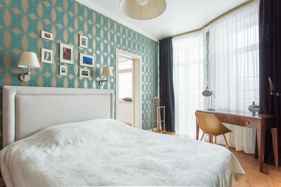 6-0-modern-bedroom-interior-design-greenish-blue-geometrical-wallpaper-Indulgence-collection-by-Harlequin-white-upholstered-bed-style-of-1950s-wooden-dressing-table-art-wall-console-desk