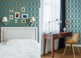 6-1-modern-bedroom-interior-design-greenish-blue-geometrical-wallpaper-Indulgence-collection-by-Harlequin-white-upholstered-bed-style-of-1950s-wooden-dressing-table-art-wall-console-desk