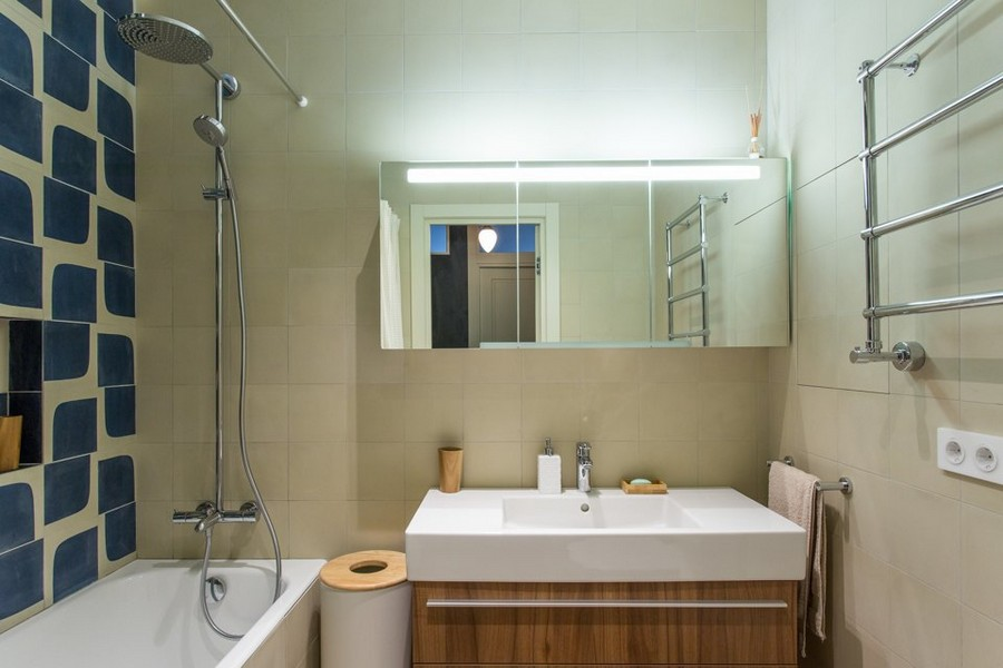 6-5-modern-bathroom-interior-design-beige-walls-geometrical-blue-tiles-style-of-1950s-towel-drying-radiator-faux-wooden-vanity-unit-white-wash-basin-rectangular-mirrored-cabinet