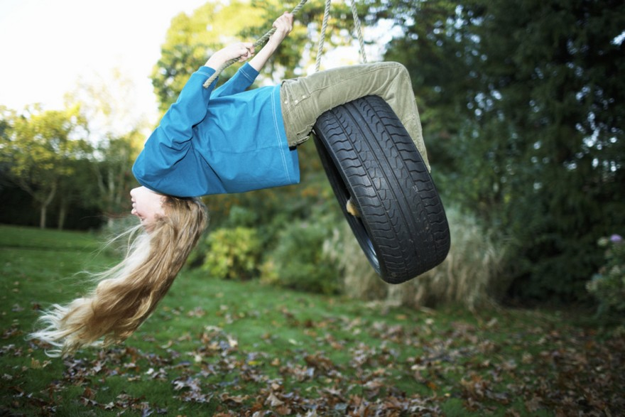 0-beautiful-garden-swing-girl-swinging-car-tire-rope