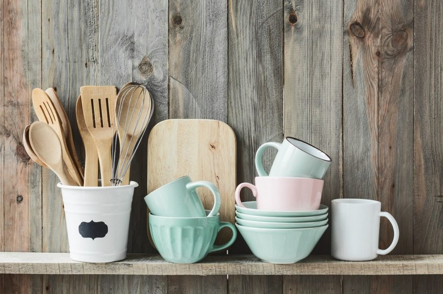 0-beautiful-kitchen-tableware-in-vintage-style-wooden-wall-pale-pastel-blue-pink-cups-bowls-wooden-cookware-cutting-board-displayed-on-open-rack-shelf