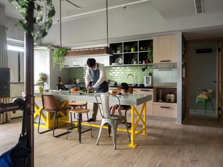 1-1-open-concept-living-room-dining-area-kitchen-interior-design-Taiwan-island-bar-table-mismatched-stools-chairs-yellow-legs-pastel-green-backsplash-clinker-wall-tiles-loft-style-motifs-father-daughter